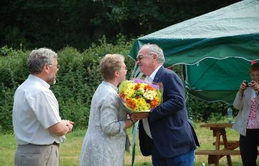Neil Torkington presenting Penny with a bouquet of flowers